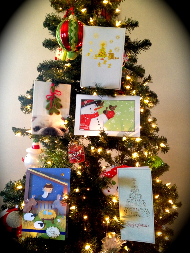 Some of the Christmas cards I've received decorate my unfinished tree.